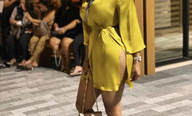 You Ask, We Answer! Angel Love Wore a $40 Mustard Zara Belted Satin Dress, Miu Miu Suede Color Block Pumps, and Beige Saint Laurent Monogram Chain Wallet at Nobu